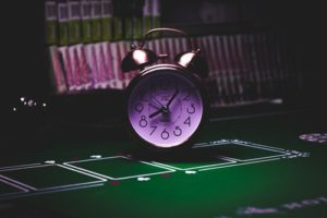 Alarm clock on casino table as tool for gaming jobs