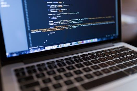 Cheap WordPress Hosting code displayed on a laptop screen.